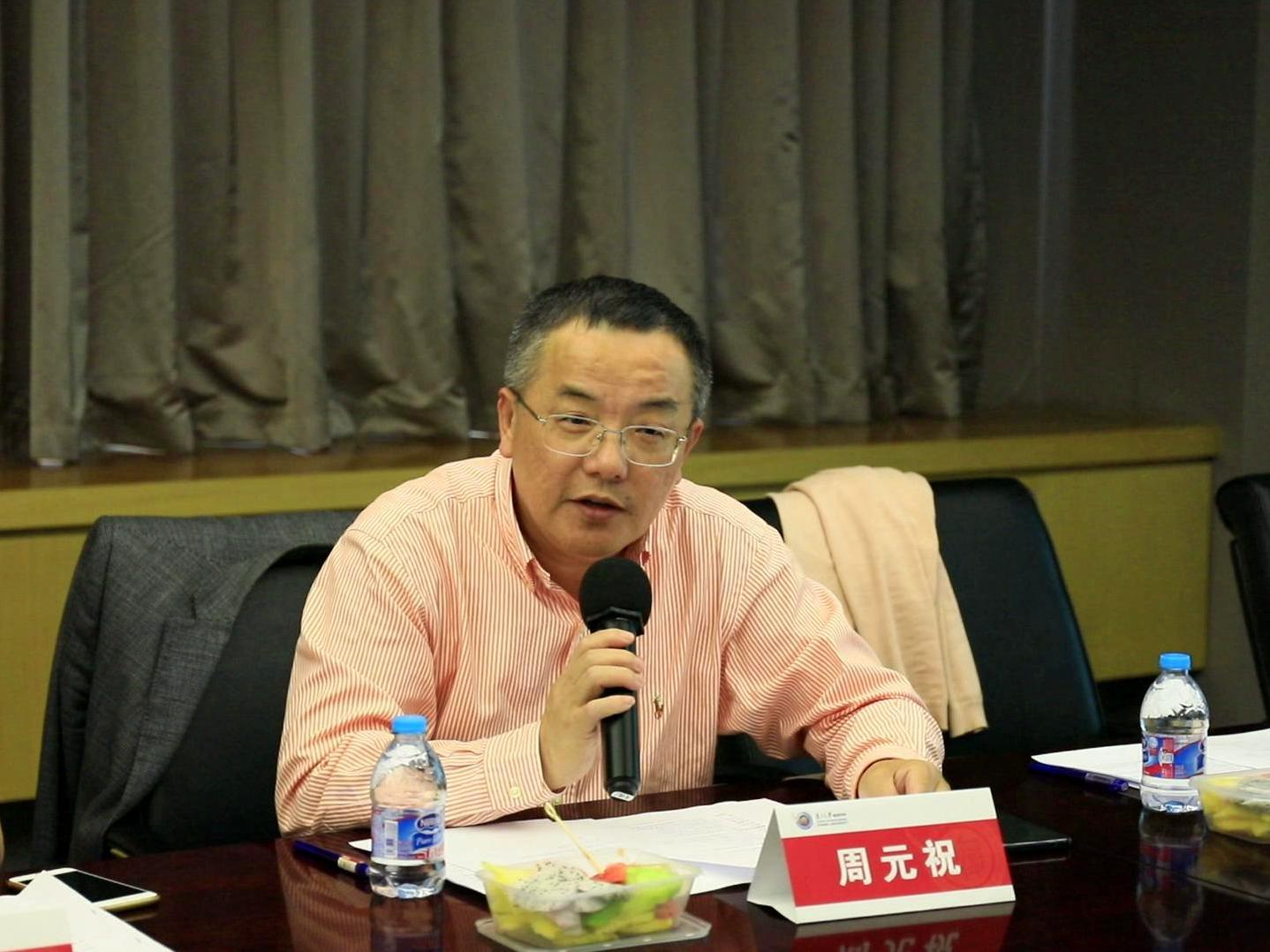上海企業文化與品牌研究所所長 周元祝